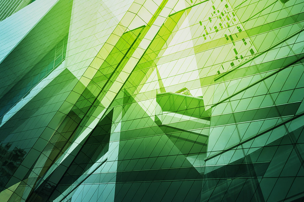 Abstract composite green-tinted photo of urban office tower window facades.