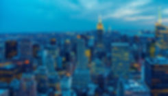 Photo of NYC skyline with view of Empire State Building at twilight with