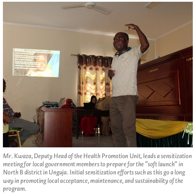 "Mr. Kwaza, Deputy Head of the Health Promotion Unit, leads a sensitization meeting for local government members to prepare for the ""soft launch"" in North B district in Unguja. Initial sensitization efforts such as this go a long way in promoting local acceptance, maintenance, and sustainability of the program."