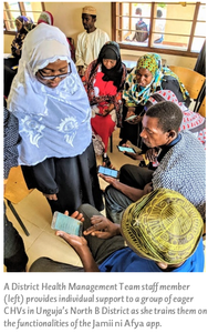 A District Health Management Team staff member (left) provides individual support to a group of eager CHVs in Unguja's North B District as she trains them on the functionalities of the Jamii ni Afya app.