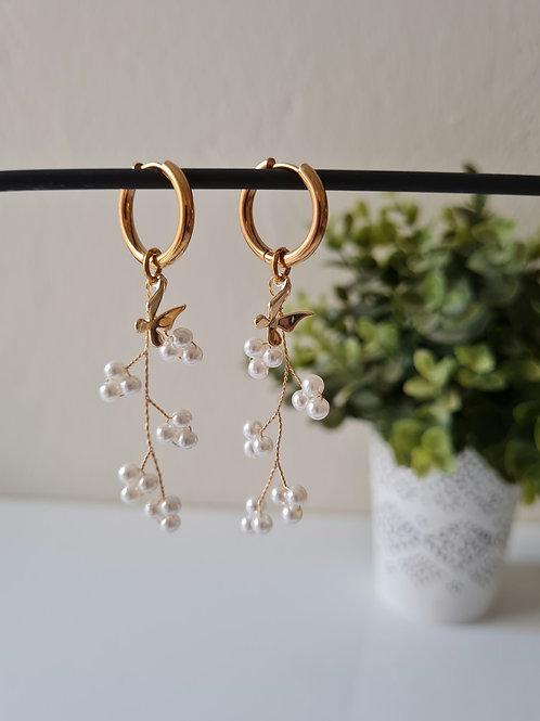The pearls earrings
