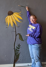 Becky with flower on wall.PNG