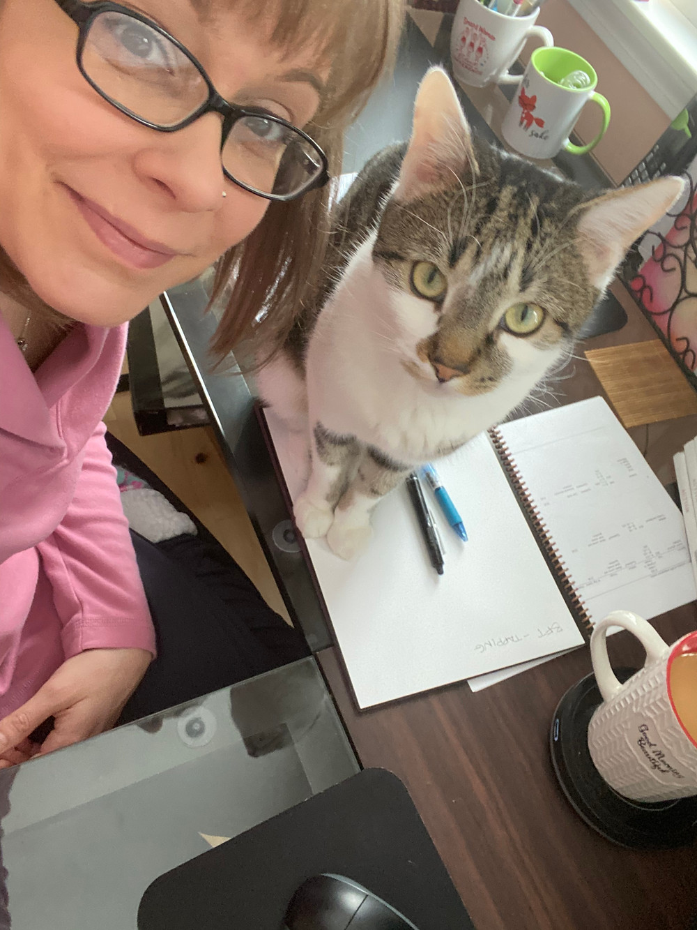 Author and her cat looking up at a camera