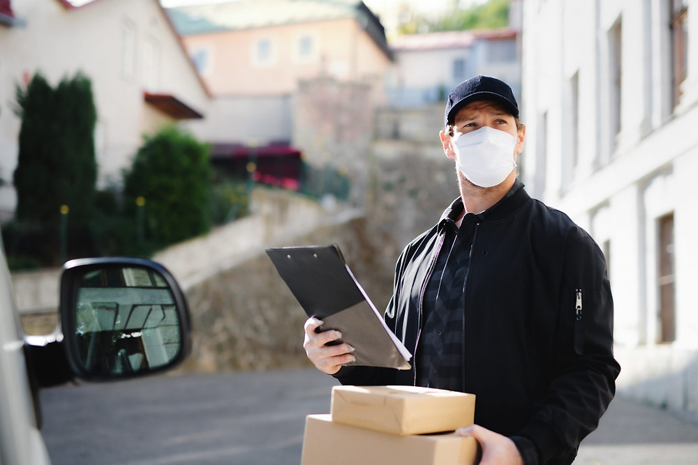 Delivery man using Custella, a transportation management system and route optimization software.