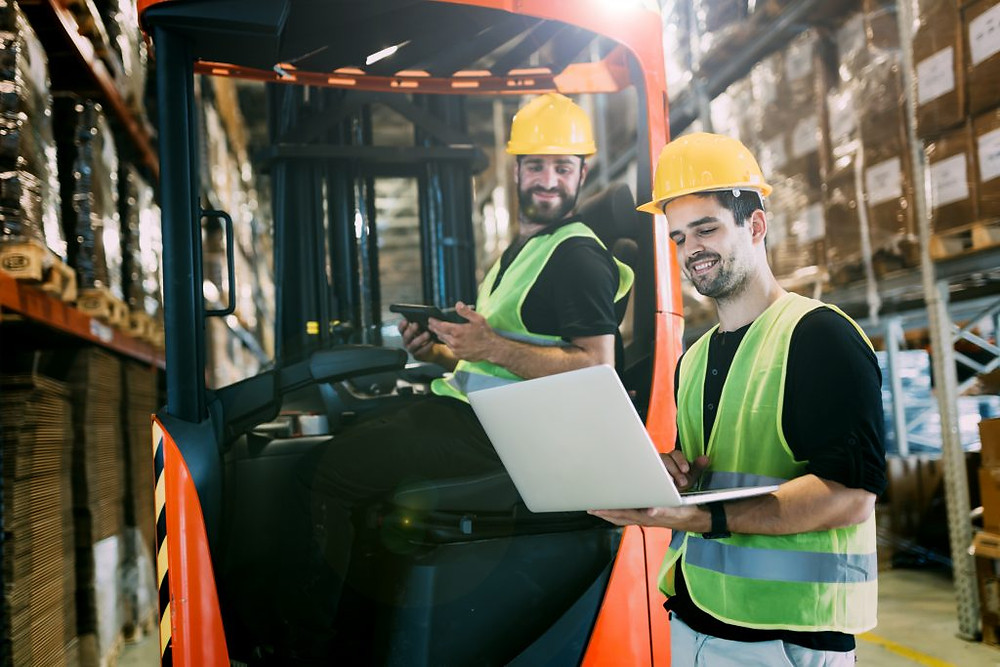 Two warehouse workers using logistics optimization software Custella