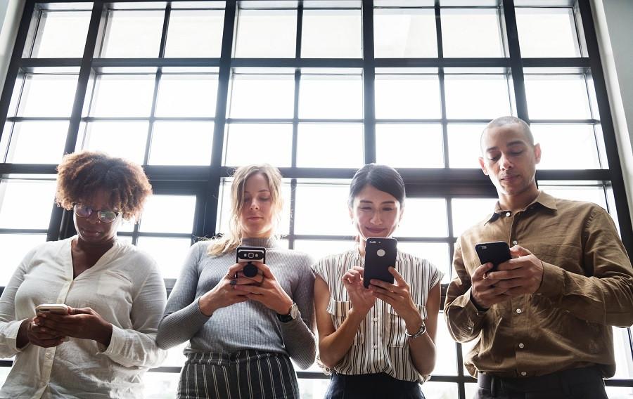 Four people using the Custella field service optimization app