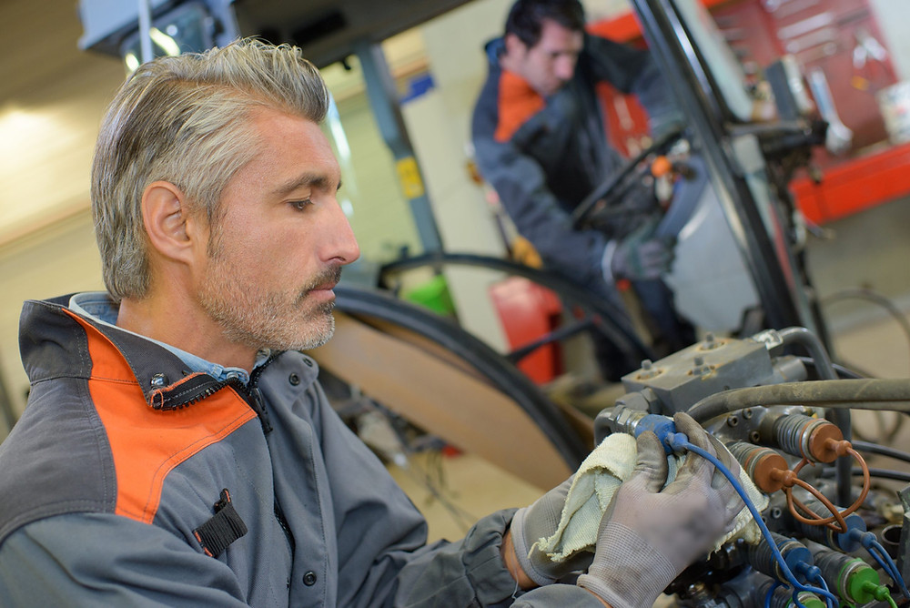 Man carrying out preventive maintenance