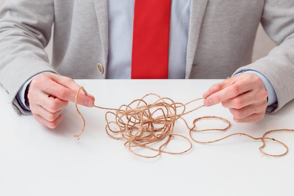 Man untangling string
