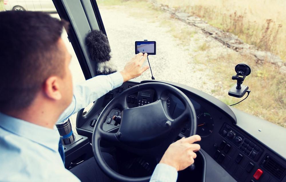 Driver using fleet management app Custella for efficiency