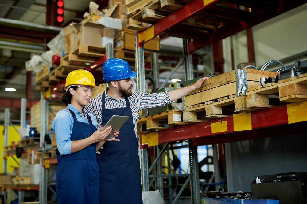 Two warehouse workers checking inventory using Custella, an asset management app