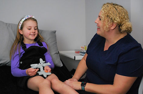 Osteopath treating a child with knee pain at Align Osteopathy Totton Southampton