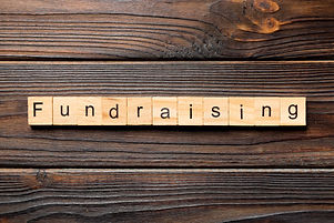 fundraising word written on wood block. fundraising text on table, concept..jpg