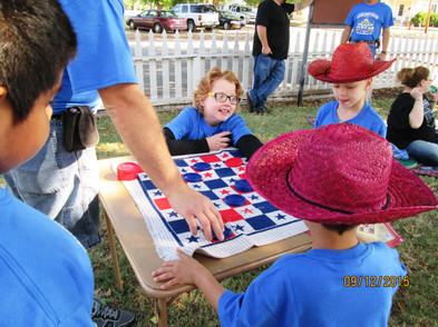 Blaine County Cancer Kids Camp playing checkers.JPG