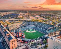 architectural and aerial photograph, commercial buildings and city skyline twilight, baltimore, md - orioles stadium