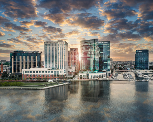 architectural and aerial photograph, commercial buildings and city skyline sunrise, baltimore, md