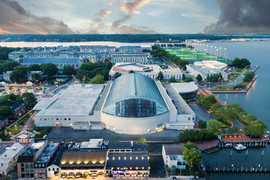 architectural and aerial photograph, commercial buildings and city skyline twilight, annapolis, naval academy, md