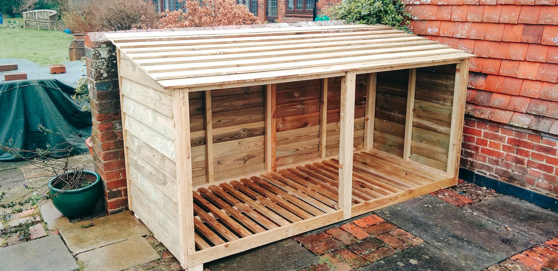 custom timber log store in back garden