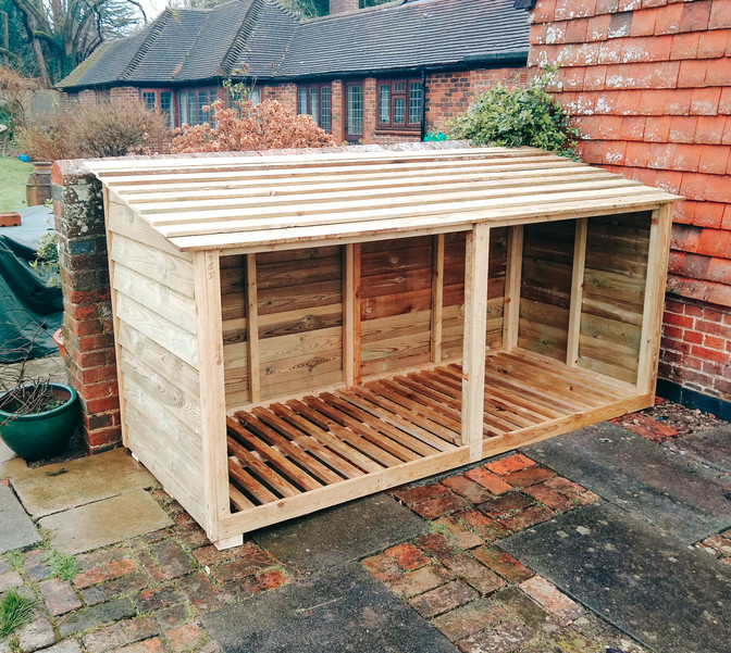 custom timber log store in back garden