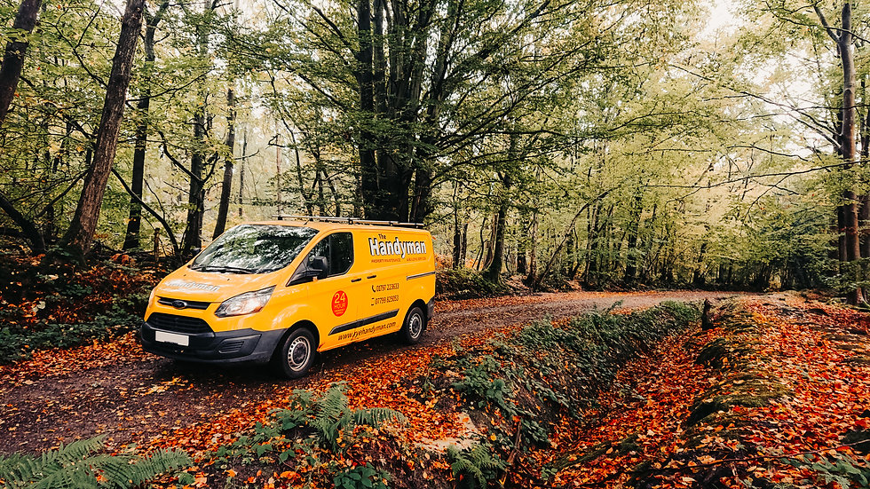 yellow handyman van in autumnal landscape