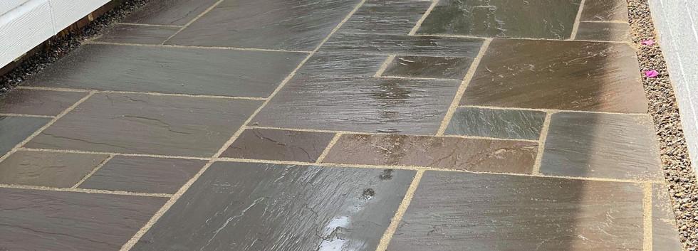 coloured sandstone paving freshly washed