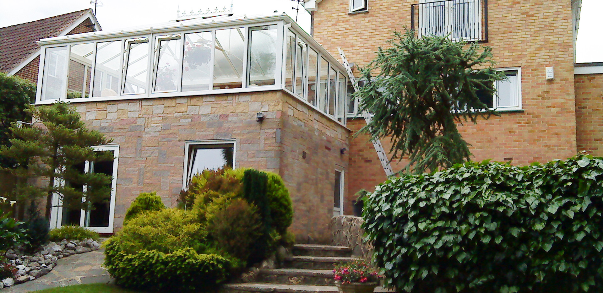 conservatory built on a brick extension overlooking back garden