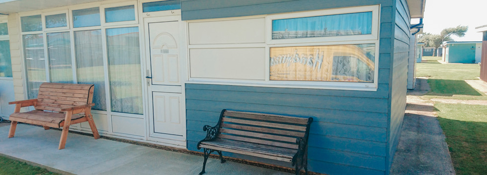 holiday chalet with new blue UPVC cladding