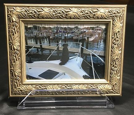 SeaClutch boat and RV picture frame holder on a decorative frame