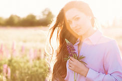 happy-young-girl-holding-lupine-flower-h