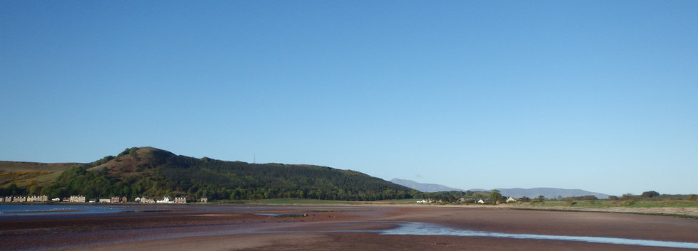 Kilchattan village (left) and the hamlet of Kingarth (right) from the northern end of the bay.
