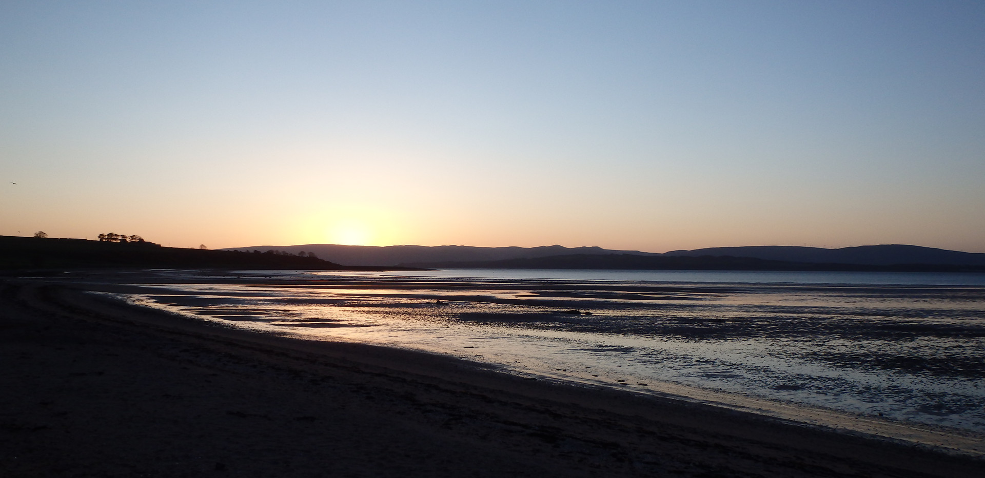 Sunrise over Kilchattan Bay.