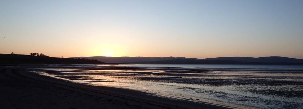 Sunrise over Kilchattan Bay.