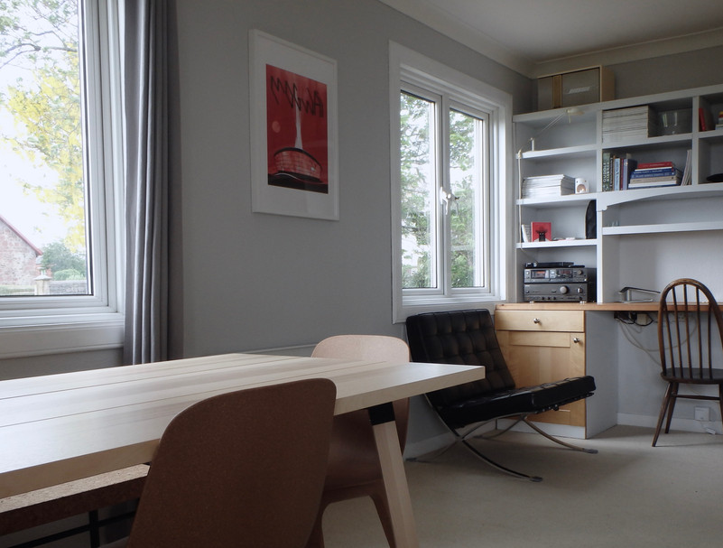 The dining area and the workspace.