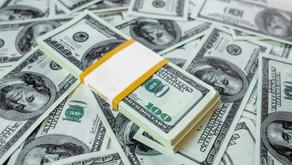 Dólar aproxima-se de R$ 5,60 com possível criação de Auxílio Brasil