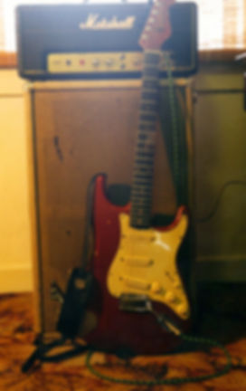 Ben's red Stratocaster and Marshall amp with a beat up cab