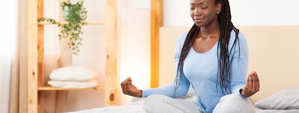 lady doing yoga in bed preparing for sleep