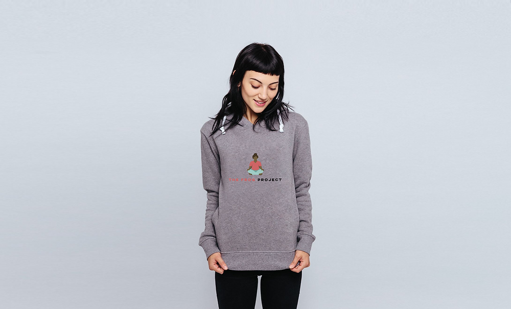 Lady wearing a Frog Project organic cotton yoga hoodie for her online yoga class