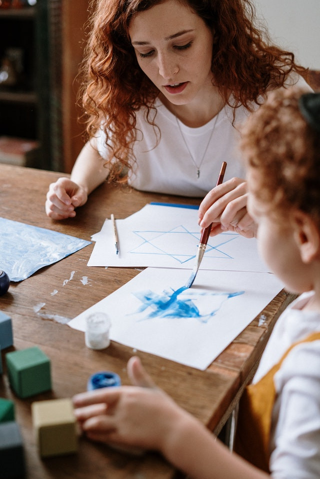 Mother and child making art together
