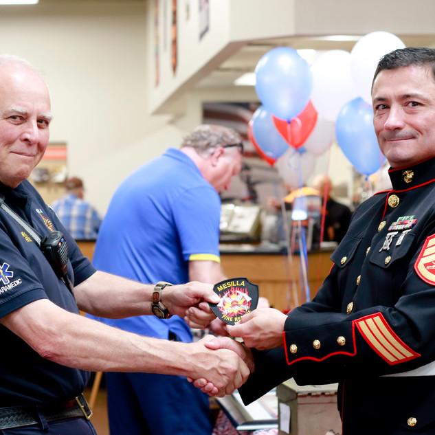 Saluting marine and Mesilla Fire chief