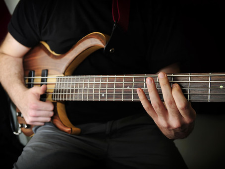 What Are the Differences Between an Acoustic and Bass Guitar?