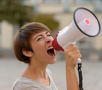 young-woman-yelling-into-a-megaphone-or-
