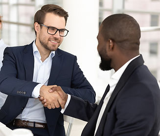 smiling-white-man-handshaking-african-am