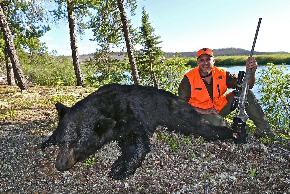 lake Barnett with a big bear he shot at less than five yards away