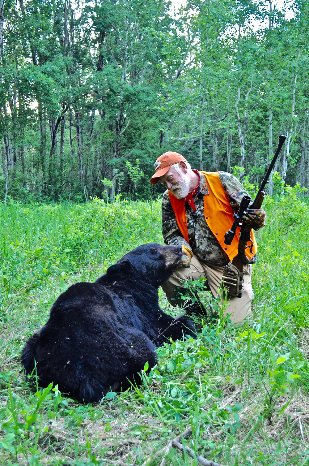 """Larry Weishuhn with a """"rangy"""" bear he took near the end of the local black bear breeding season.  The bear was in a run-down state.  Not one of the bears that charged him, but still an aggressive boar."""