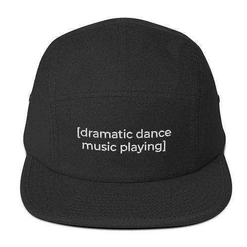[dramatic dance music playing] Cap