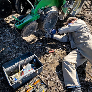 Dr. Vyn repairing planter row unit