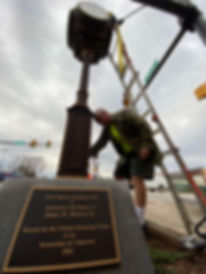 The Greer Station Community Clock gets ready to come down.