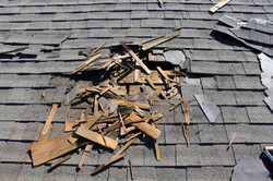 Roof construction site. Removal of old roof, replacement with new shingles, equipment and repair. Ro