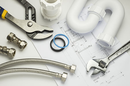 A selection of plumbing tools and fittin