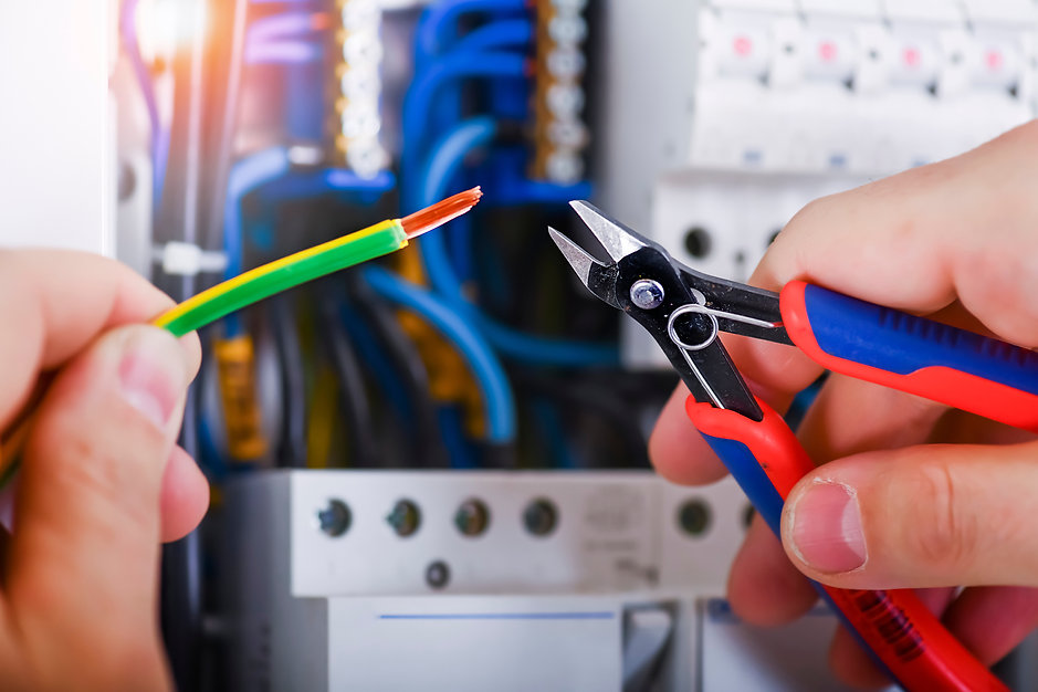 Electrician cutting wires detail. Electr