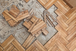 Damaged wooden floor -Ruined flooring from moisture and water